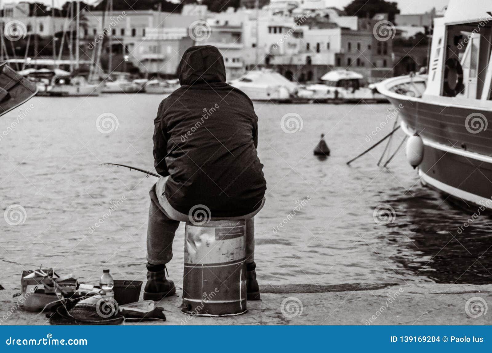 Old unemployed man fishing