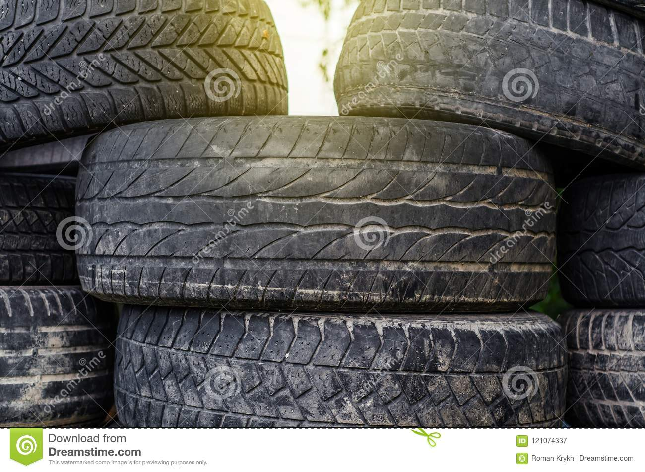 Old used car tires stacked in stacks