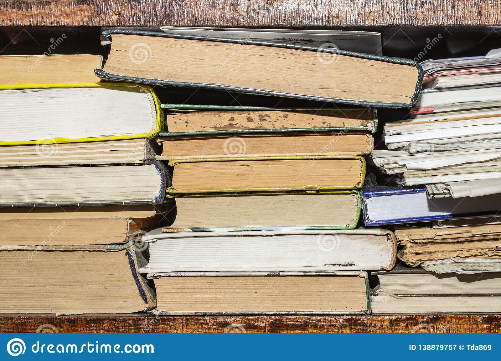 Old and used hardback books or text books seen from above. Books and reading are essential for self improvement, gaining knowledge