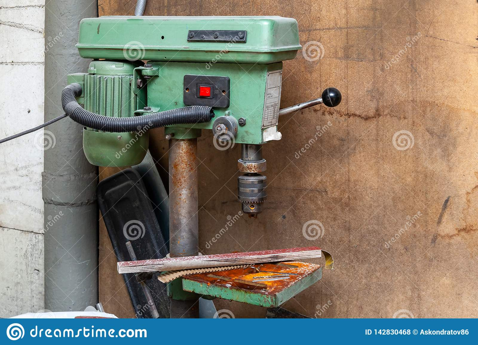 Old Vertical Green Drilling Machine With A Big Red Power