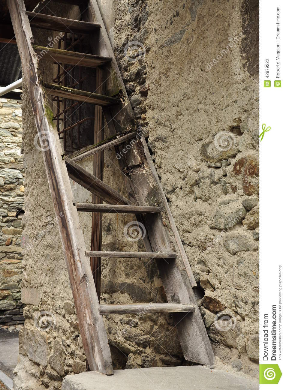 Old Village Broken Wood Ladder And Stone Wall Stock Photo