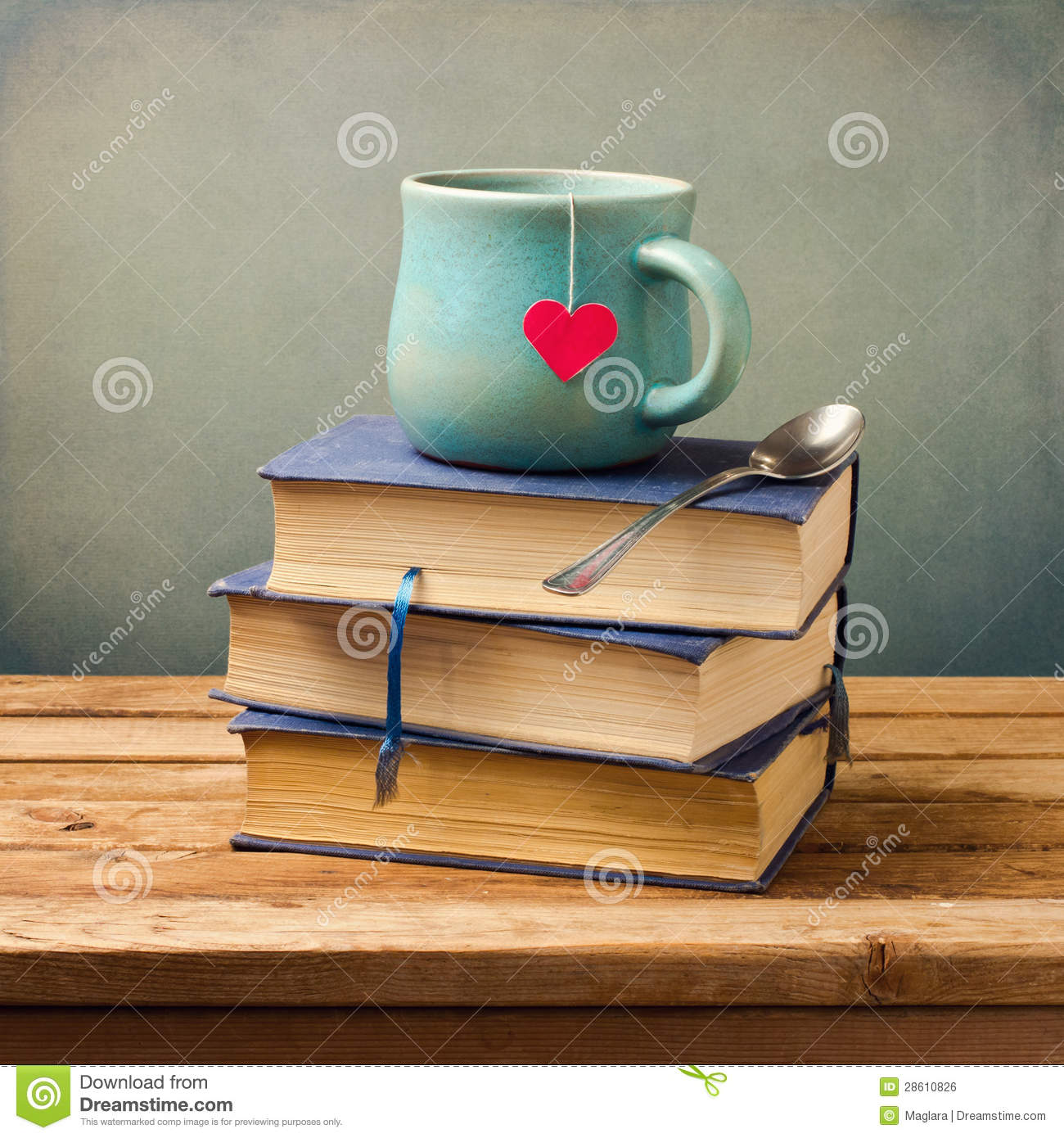 Old vintage books and cup with heart shape