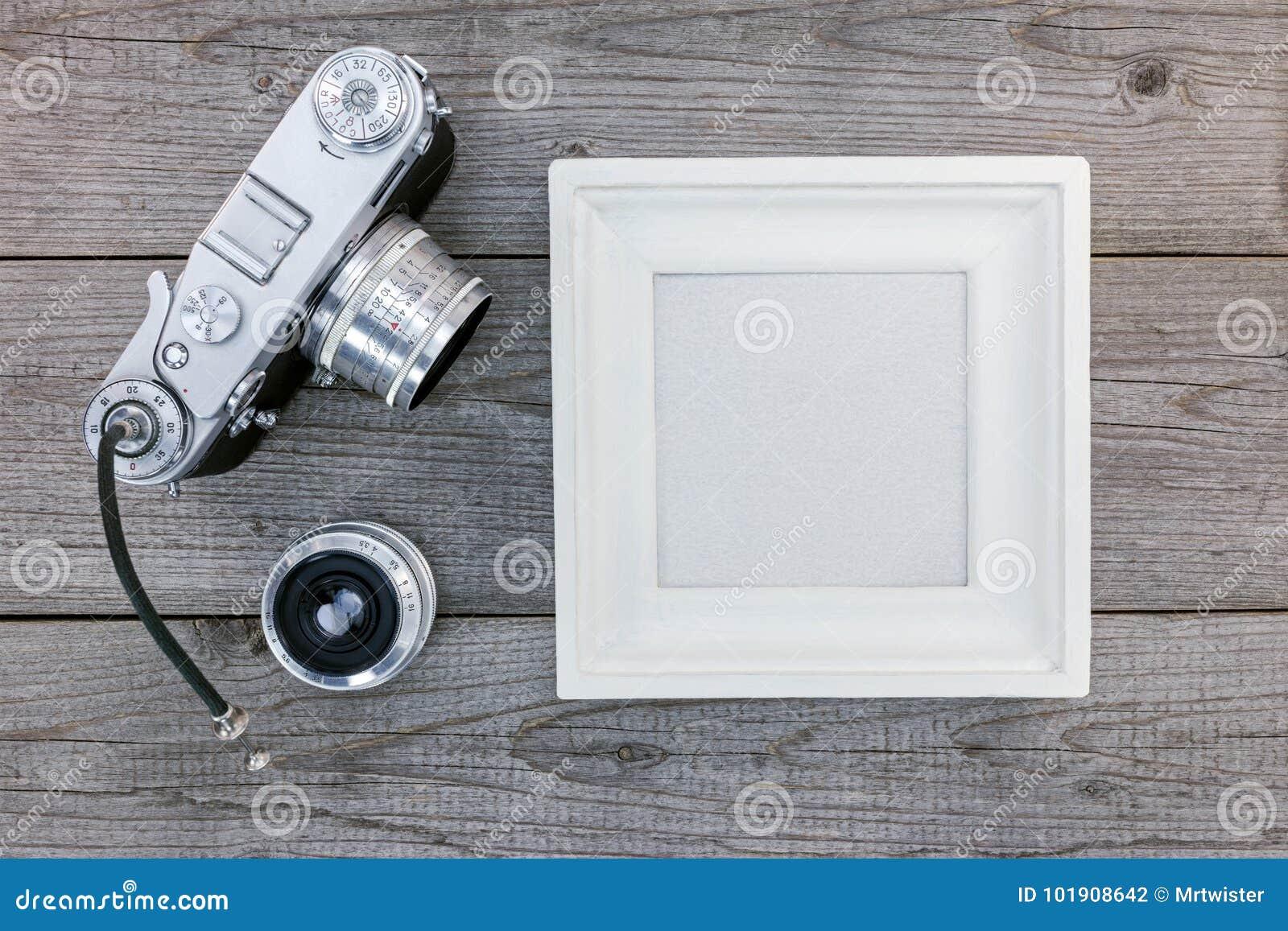 Old Vintage Camera, Lenses And White Empty Frame On Wooden Backg ...