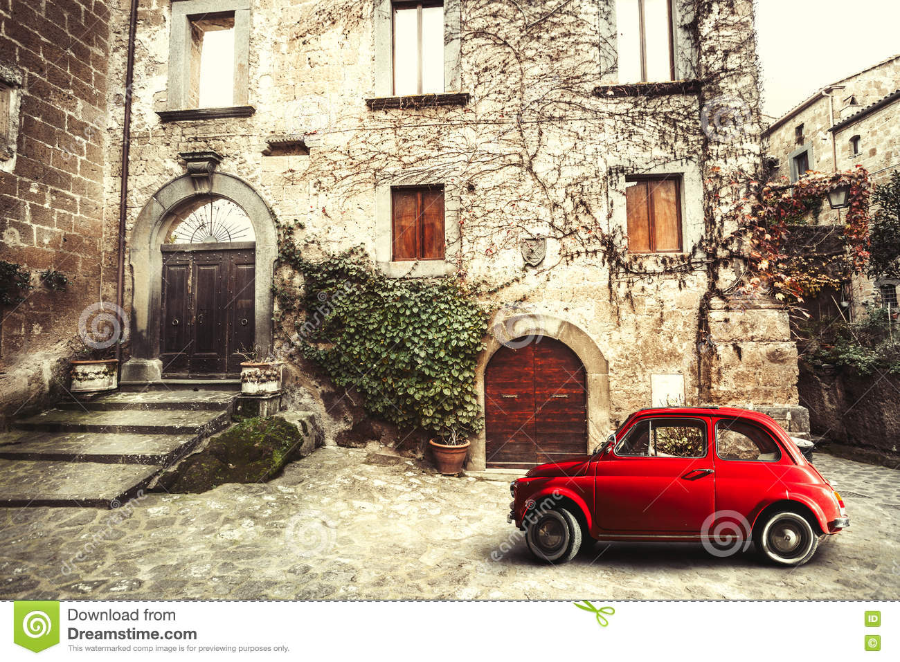 Old vintage italian scene. Small antique red car. Fiat 500