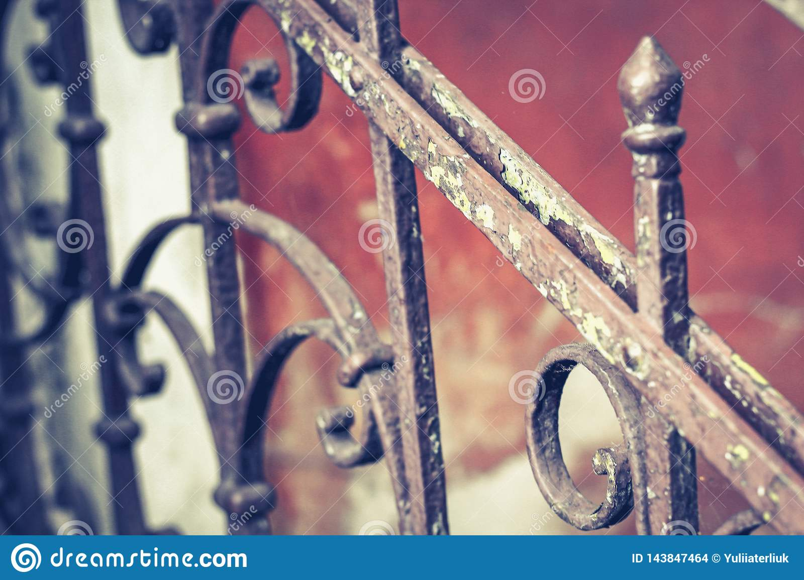 Old vintage railing with rust on the stairs in the house. Forged railing steps in the house