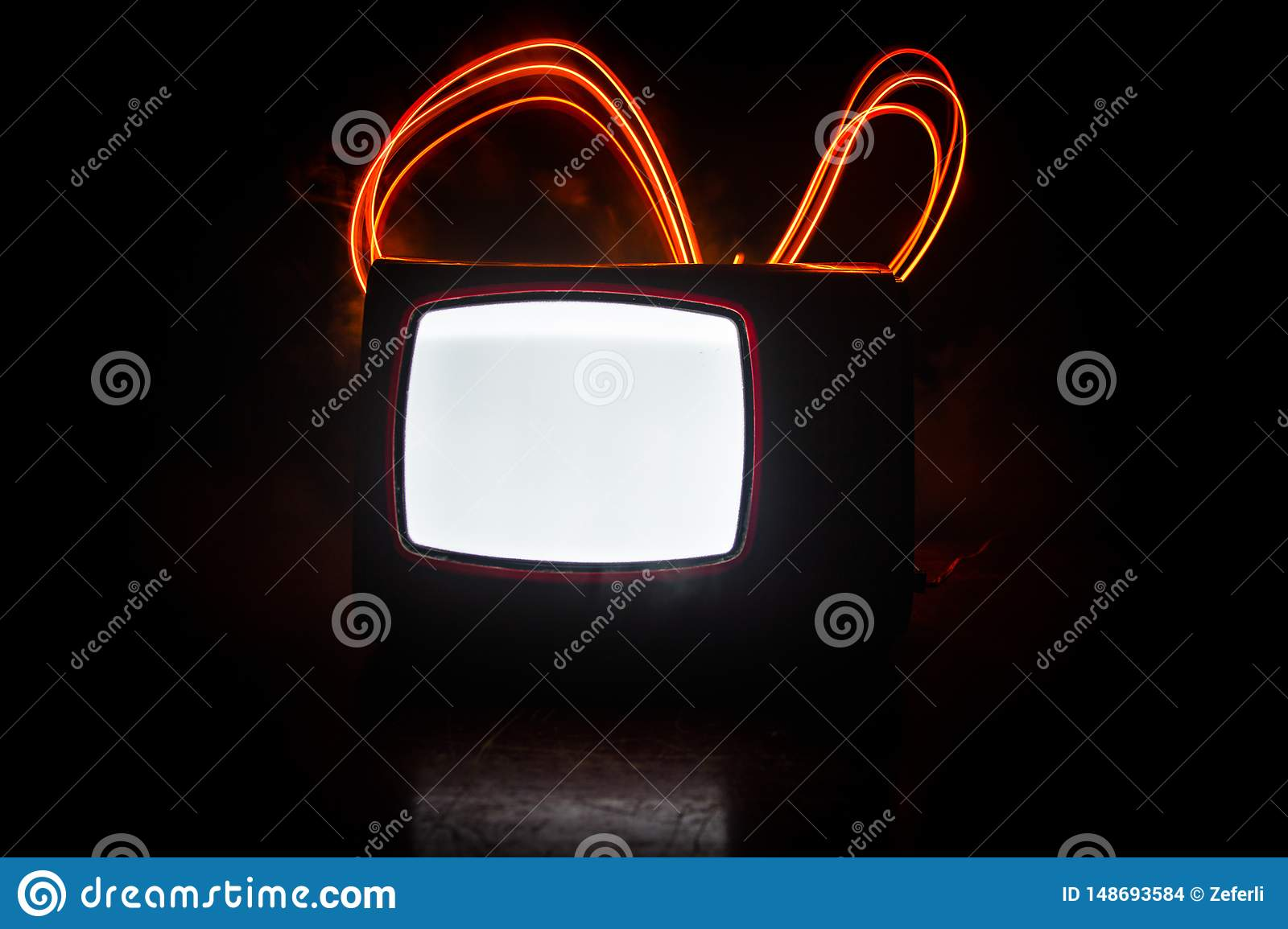 Old vintage red TV with white noise on dark toned foggy background. Retro old Television reciever no signal