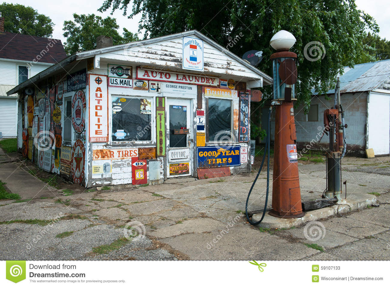 Old vintage retro gas or filling station. The building is covered with ...