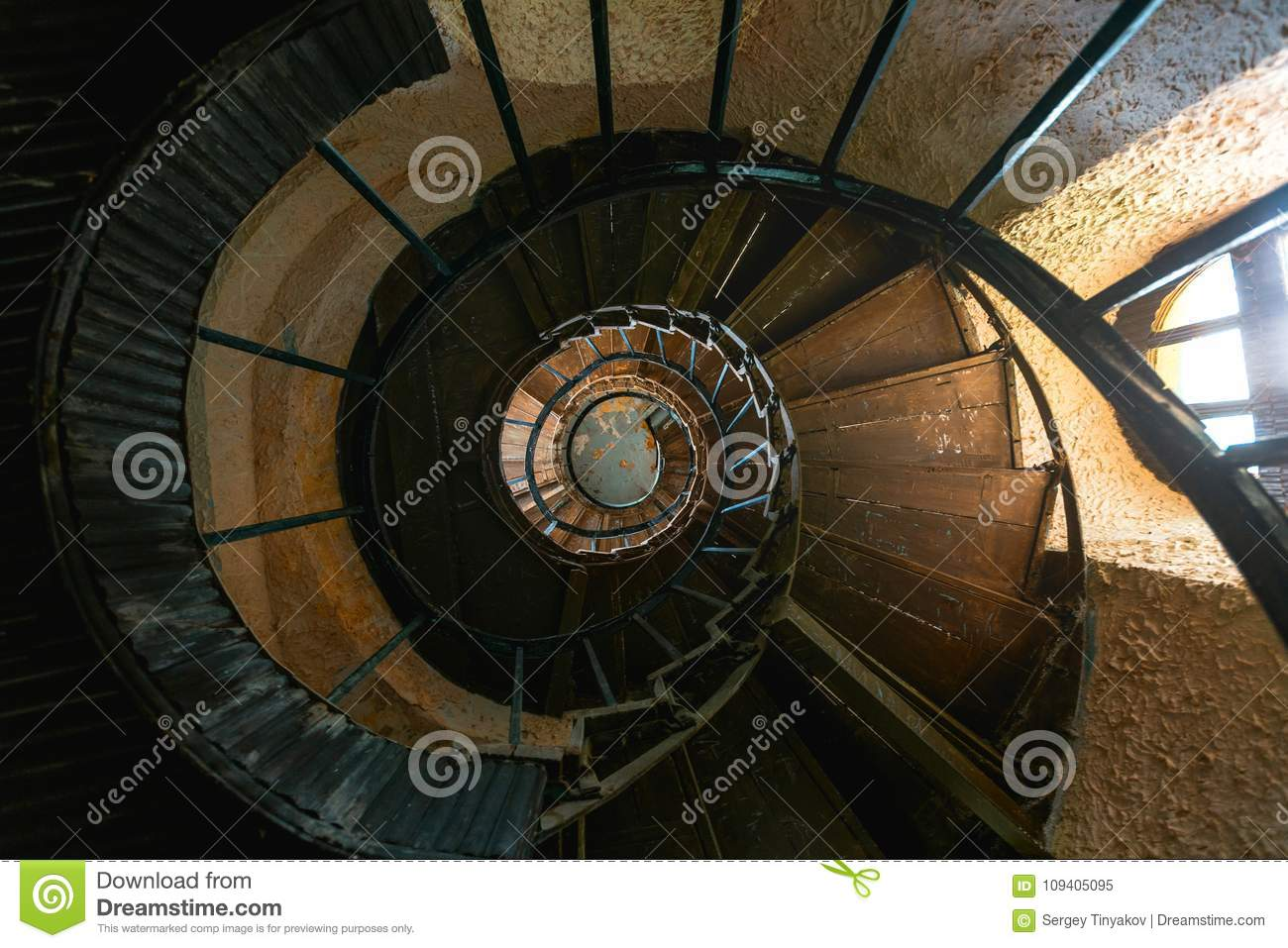 Old Vintage Spiral Staircase In Abandoned Mansion House. Top View