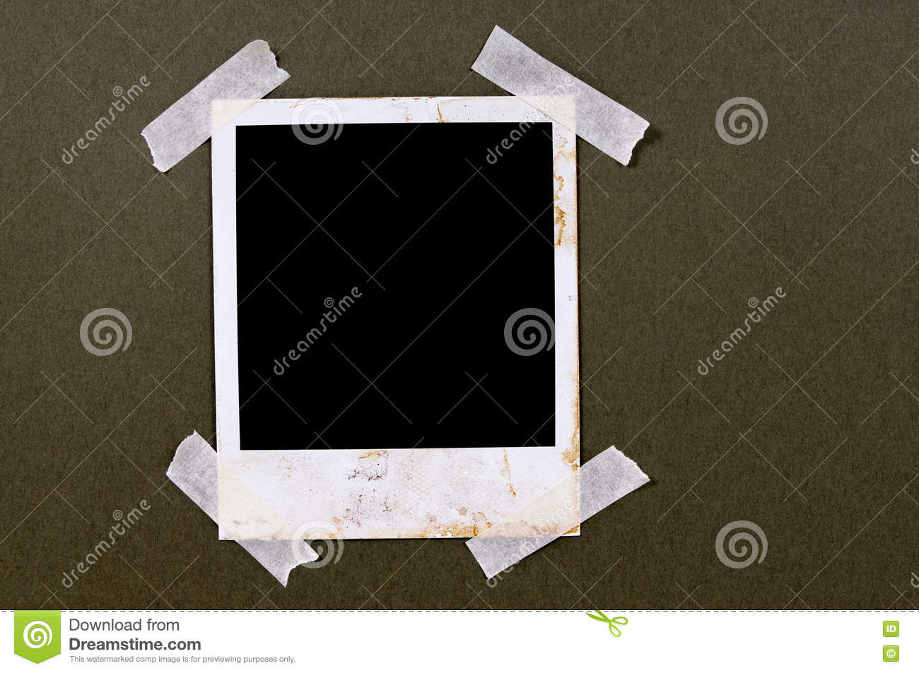 Old vintage stained polaroid style blank photo print frame sticky tape