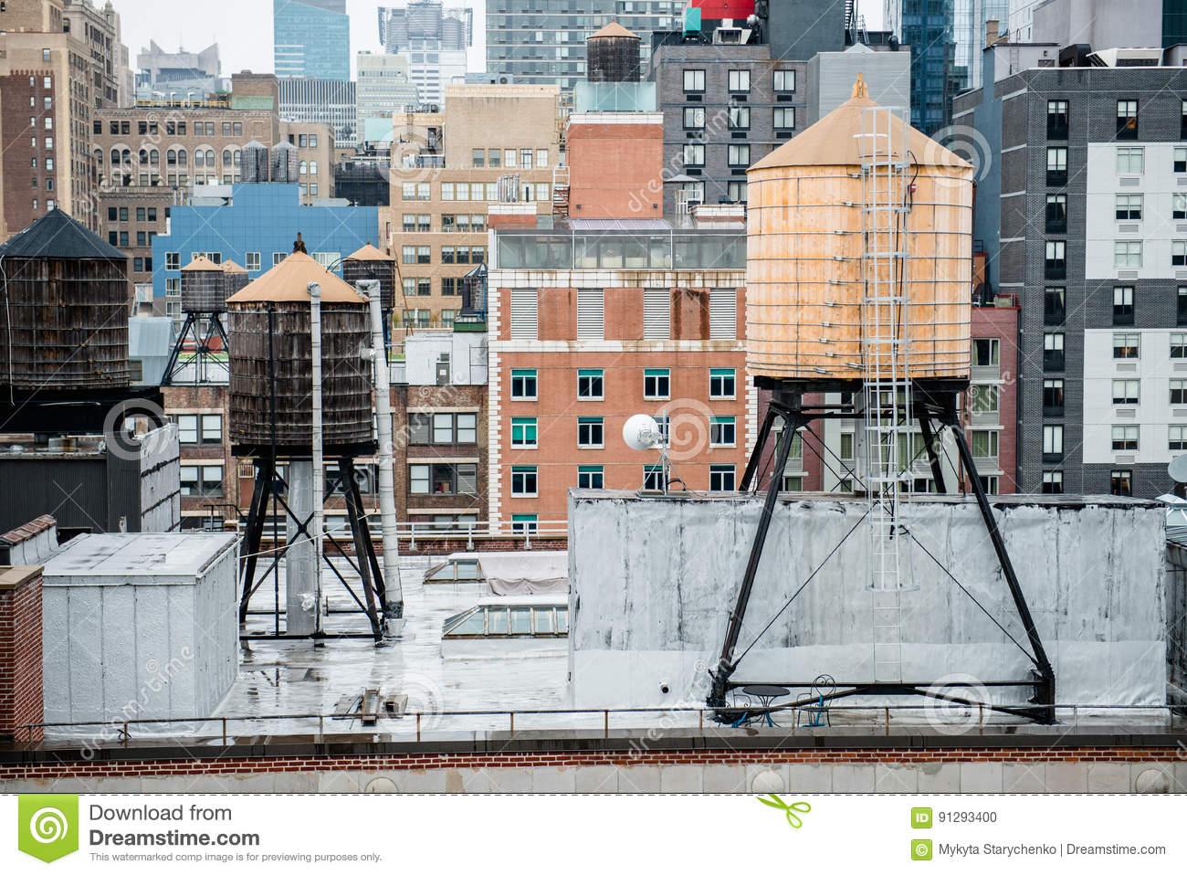 Old vintage water tanks on the roof in New York City Manhattan midtown.