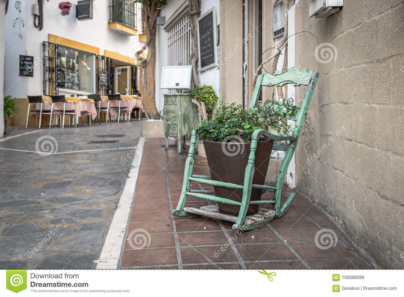 Download Old Vintage Wooden Rocking Chair As A Decoration Element For  Flower Pot Stock Image