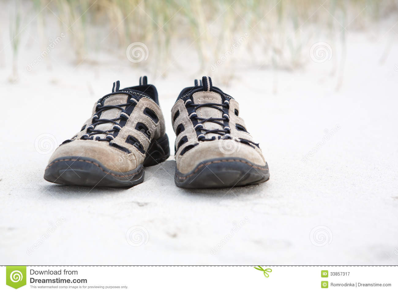 Old Walking Shoes On Beach With White