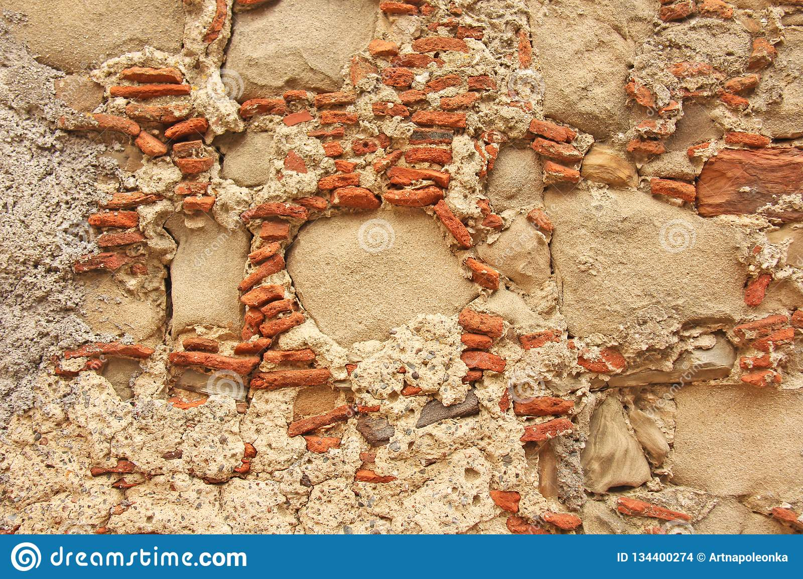 Old Wall of Big and Small Stones. Terracotta and Beige Stones. Terracotta Background. Background of the Old Terracotta Stones. For