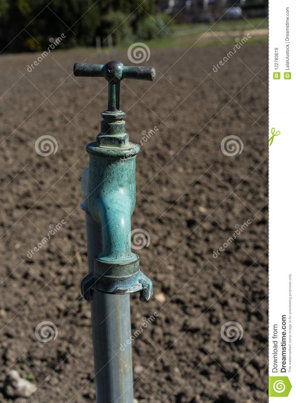 Old Water Pipe, Faucet With Nature Brown Earth Background A Old ...