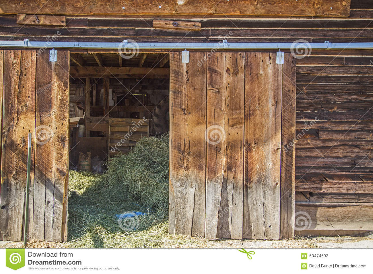Old Weathered Barn Door Hay Sunlight Stock Photo Image