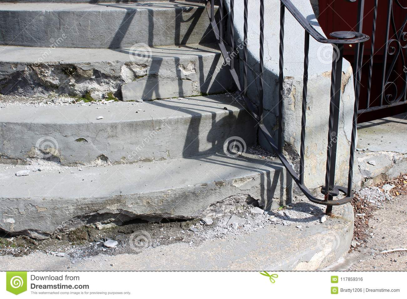 Download Set Of Cement Stairs In Need Of Repair With Black Wrought Iron  Railing For Support