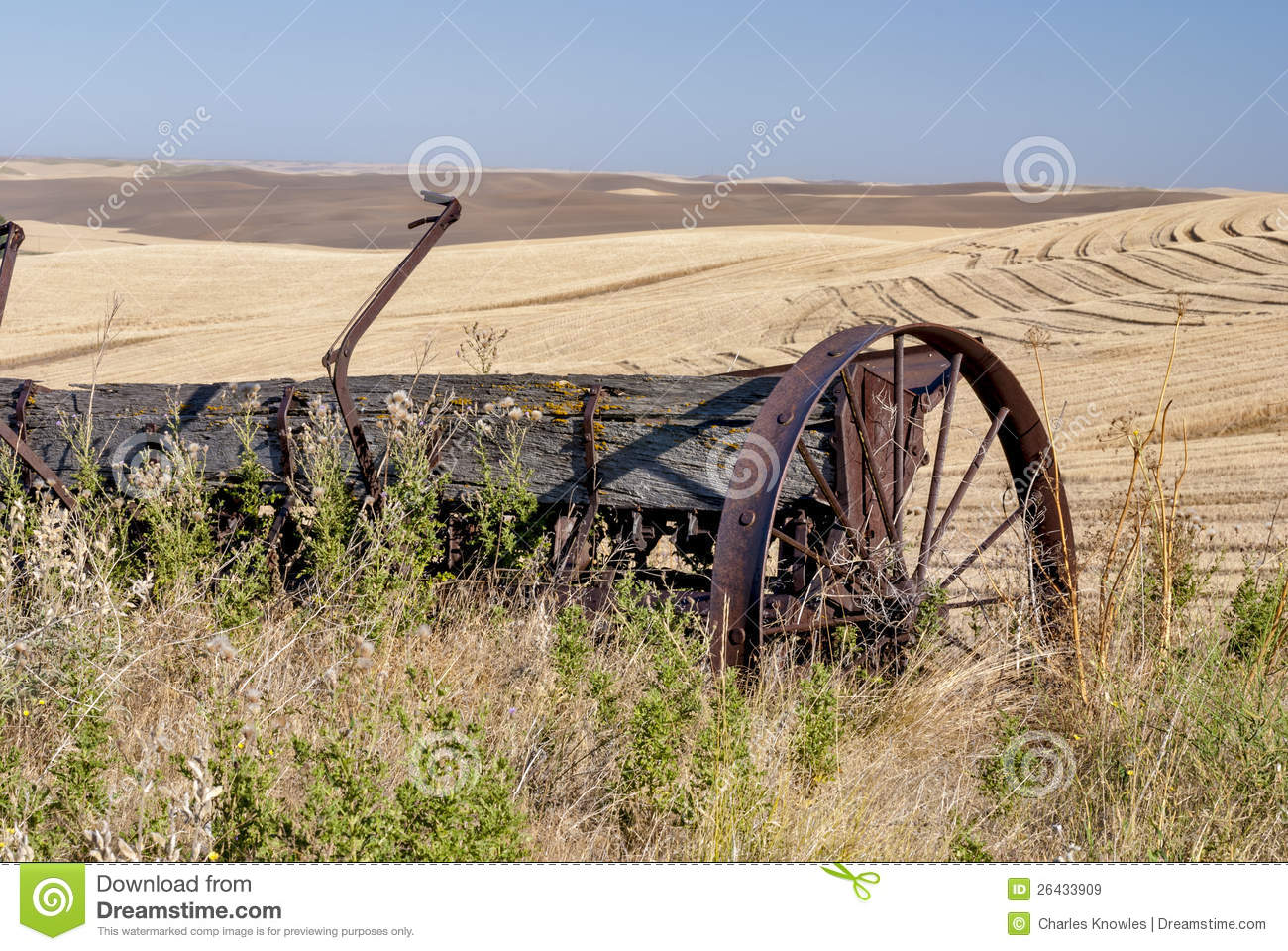 Old weathered farm equipment in wheatfields