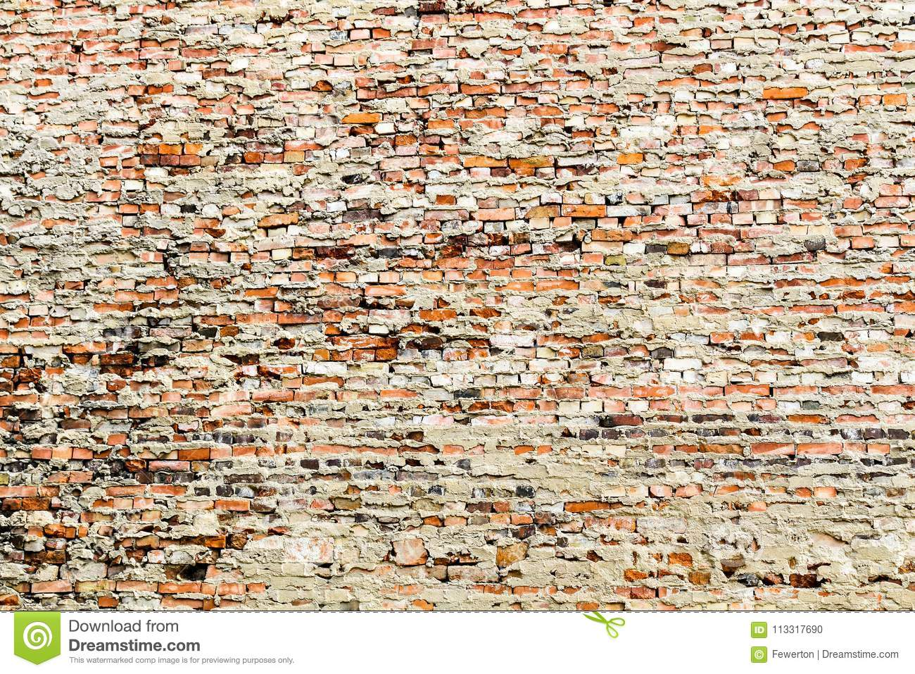 Old and weathered grungy red brick wall partly covered by excess cement and grey paint