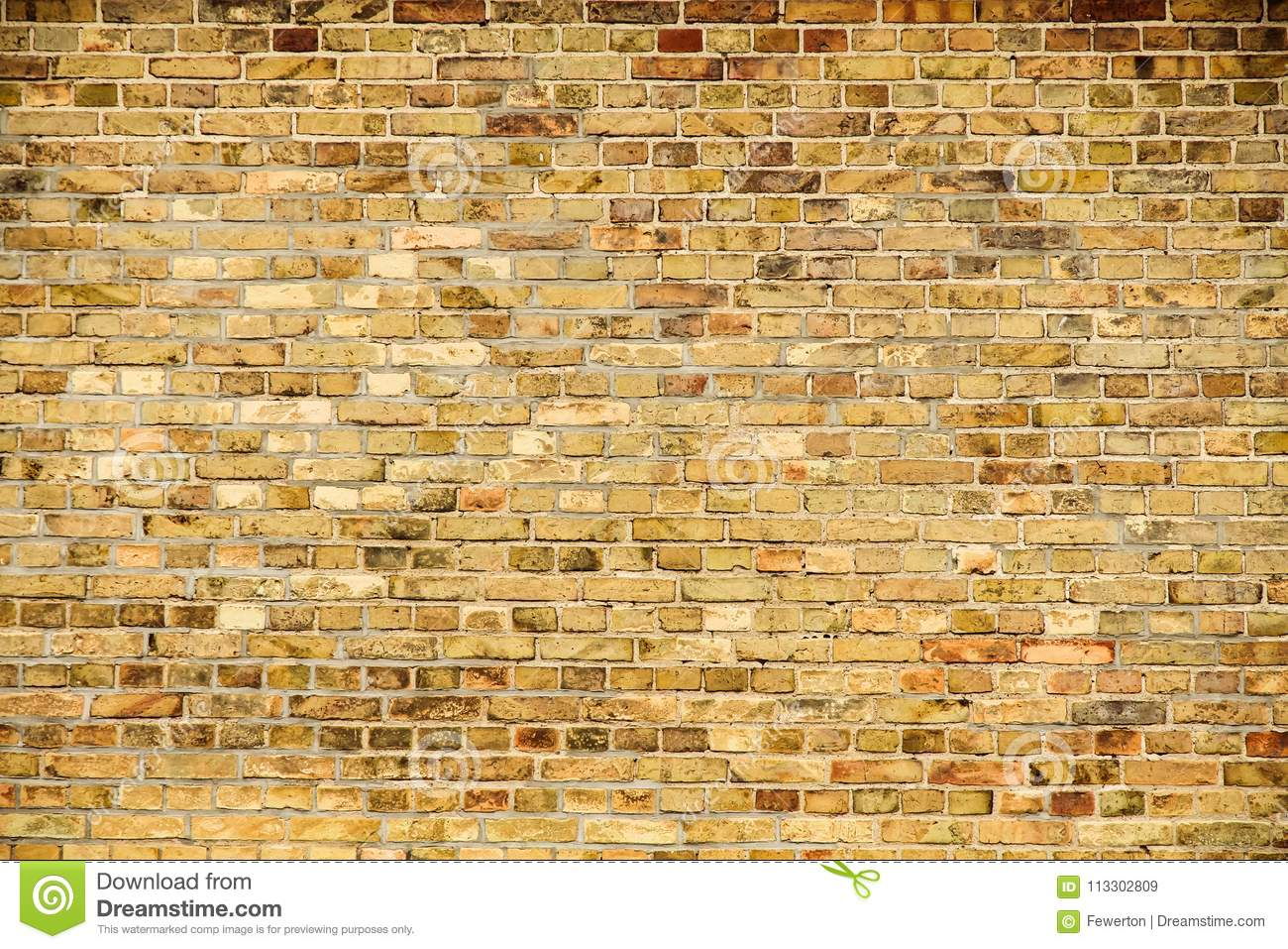 Old and weathered grungy yellow and red brick wall as seamless pattern texture wall background