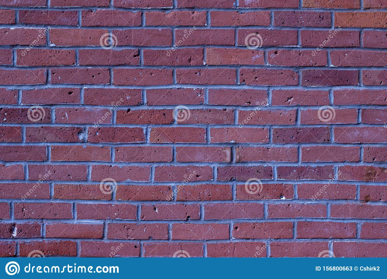 Old weathered shabby chic rose red color brick wall texture