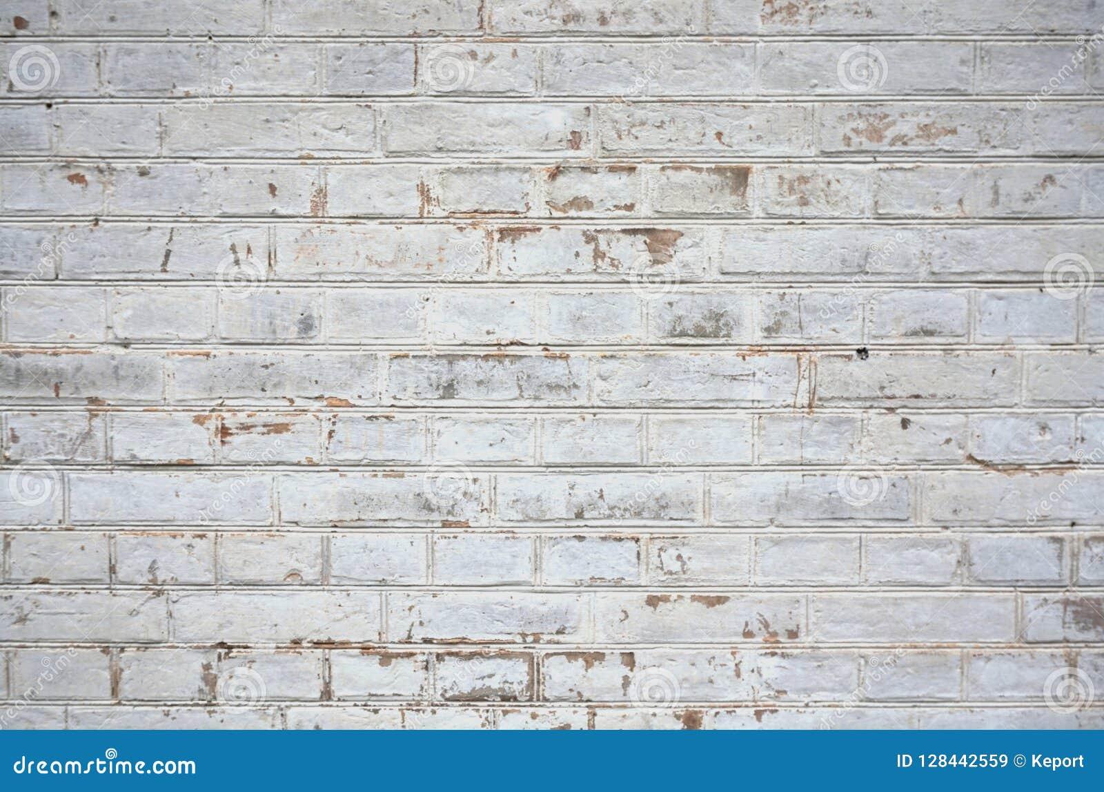 Old weathered white brick wall