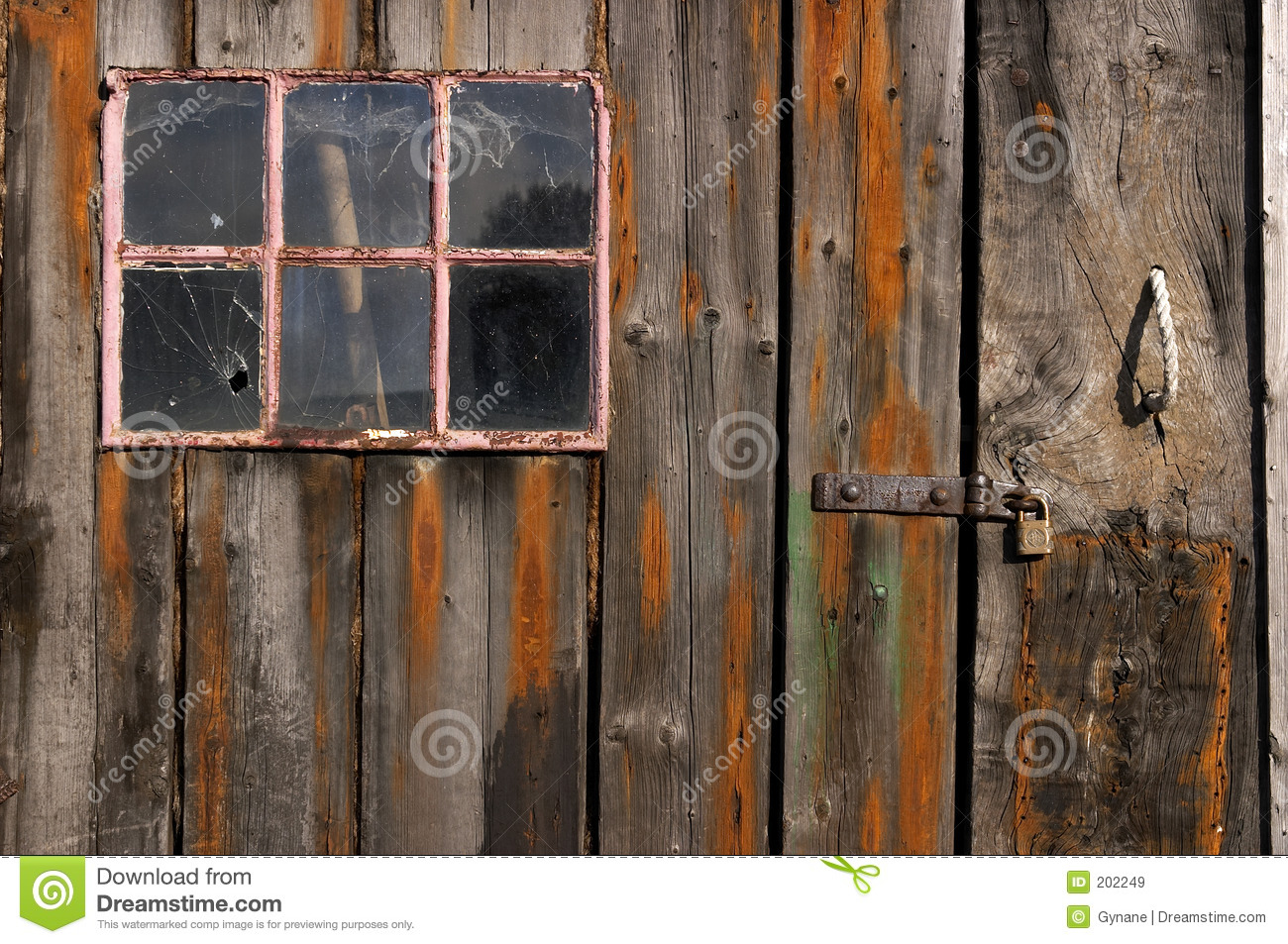 Worn Down Wooden Planks ~ Old weathered and worn wooden planks with door pink