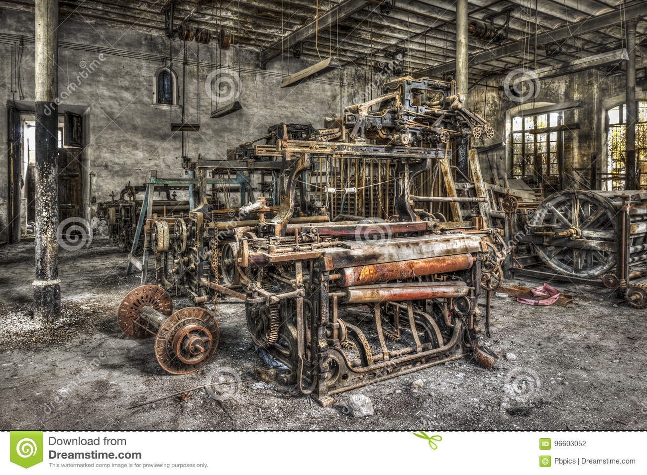 Old weaving looms and spinning machinery at an abandoned textile factory