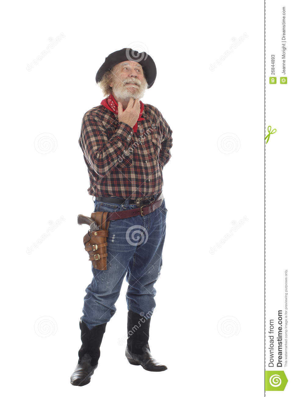 Old West Cowboy Stands Scratching His Beard Stock Image