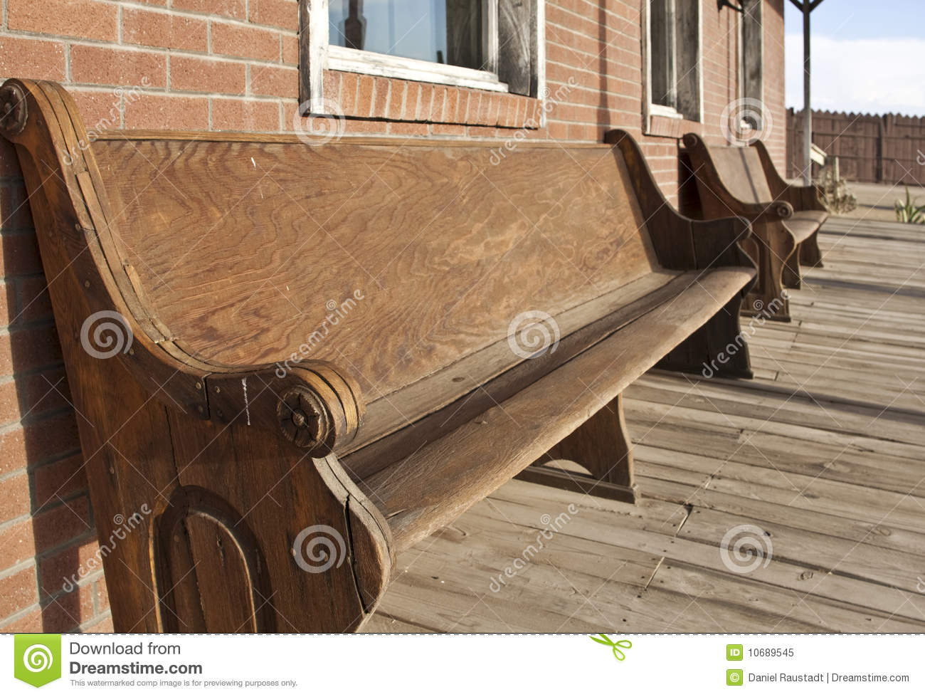 Old Western church pews outside bank