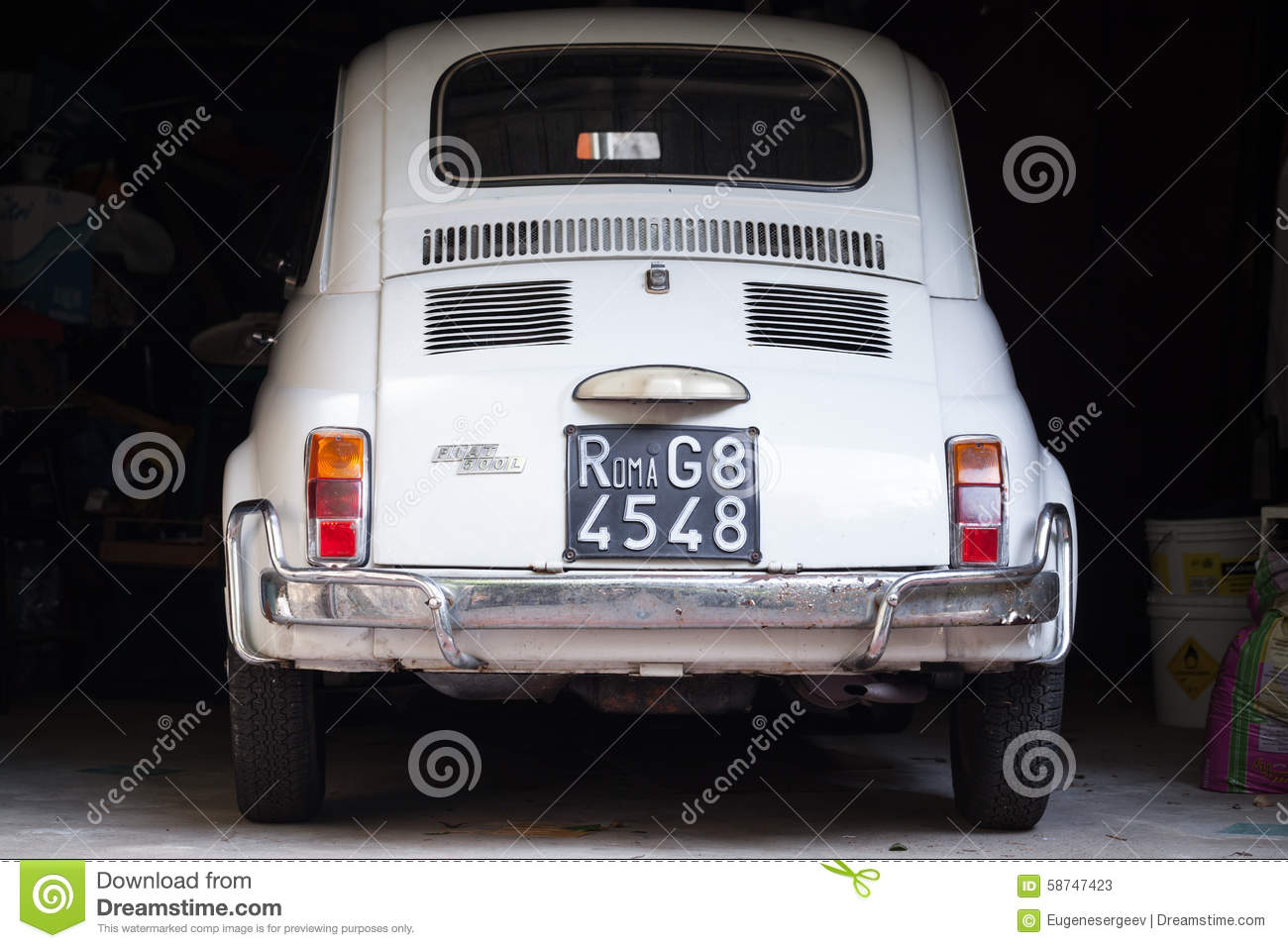 old white fiat 500 l car stands in dark garage editorial. Black Bedroom Furniture Sets. Home Design Ideas