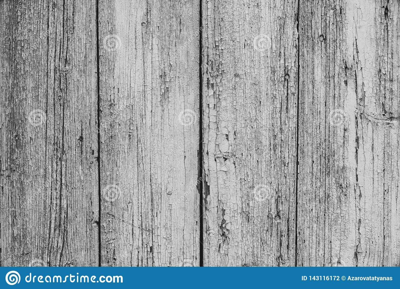 Old white painted rustic fence in vintage style. Retro wood texture background. Gray wooden table. Dirty white wood surface.