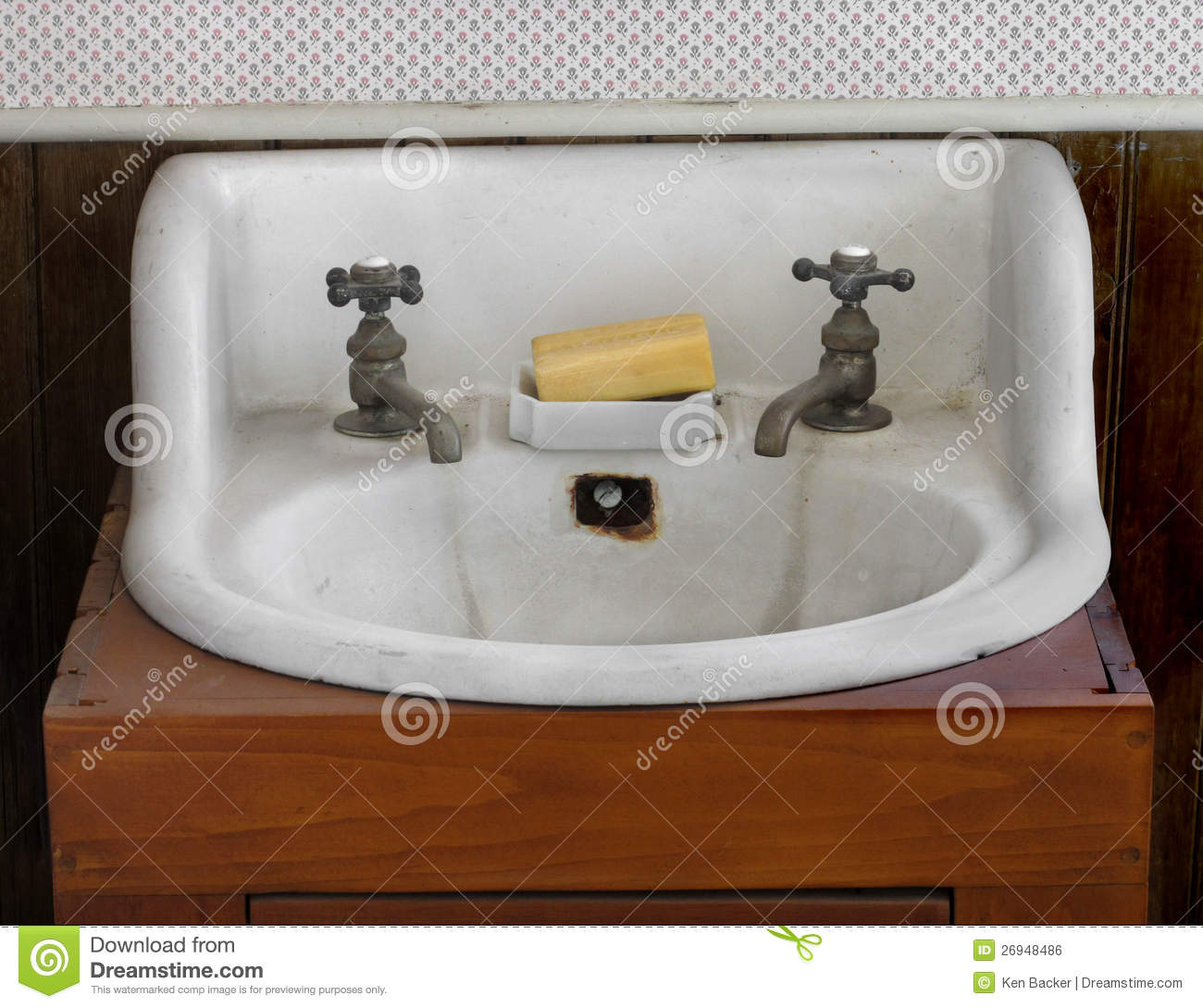 Elegant Old White Sink And Taps. Royalty Free Stock Image