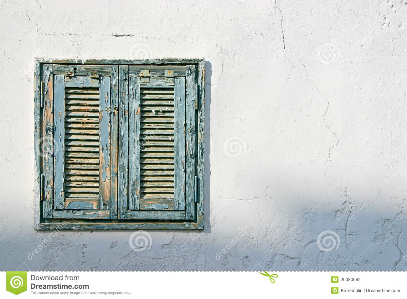 The Old Window With Blue Shutters On A White Wall Stock