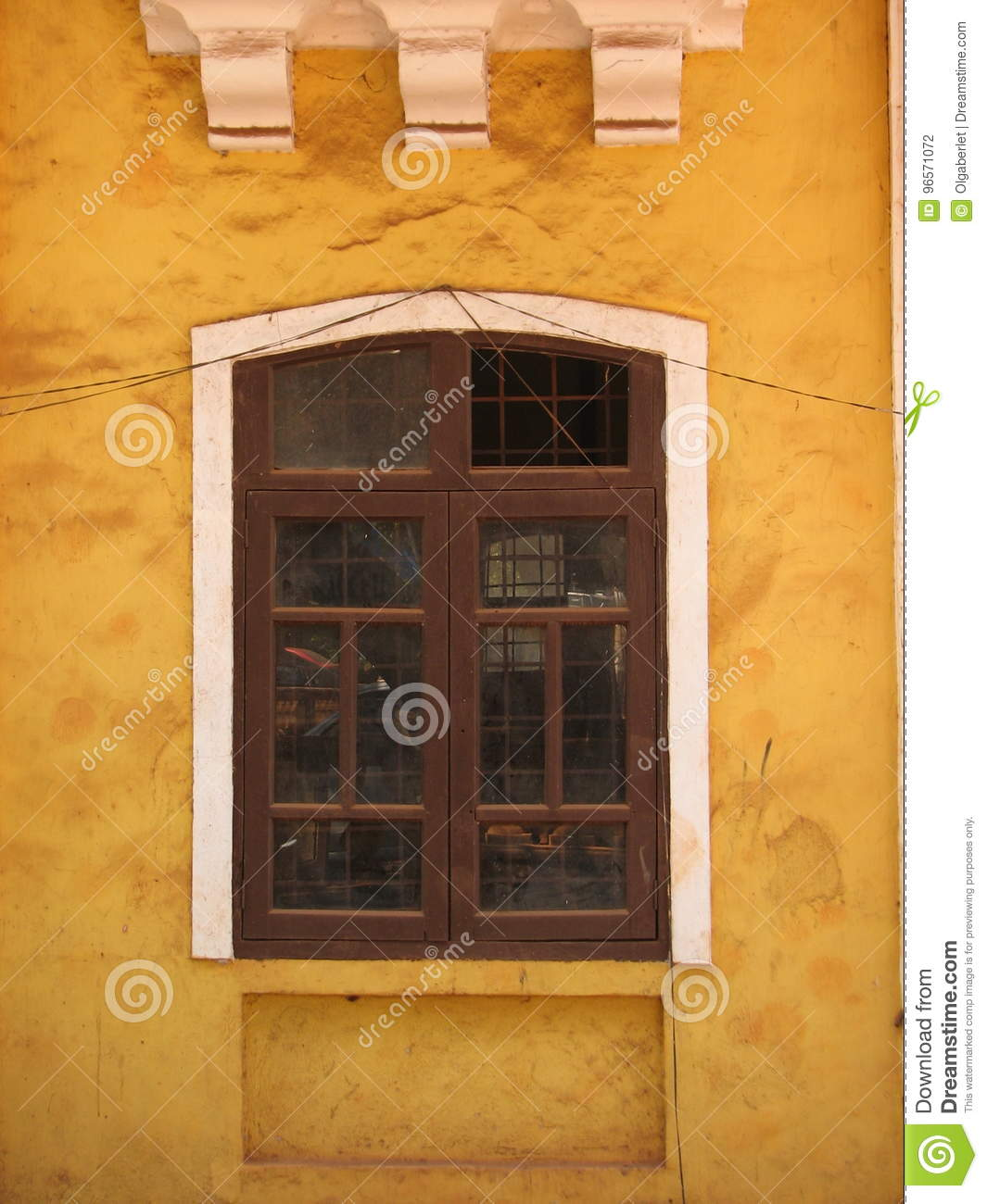old window with terra-cotta tiled roof. An architectural details from Goa, India.