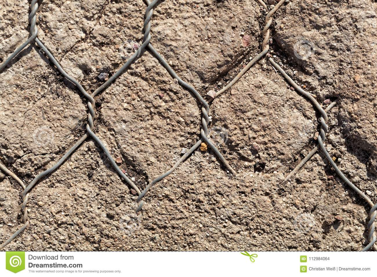 Old wire netting in concrete