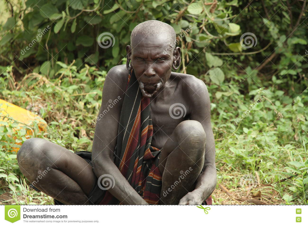 Old woman of the ethnic Mursi. Valley of the Omo. Ethiopia