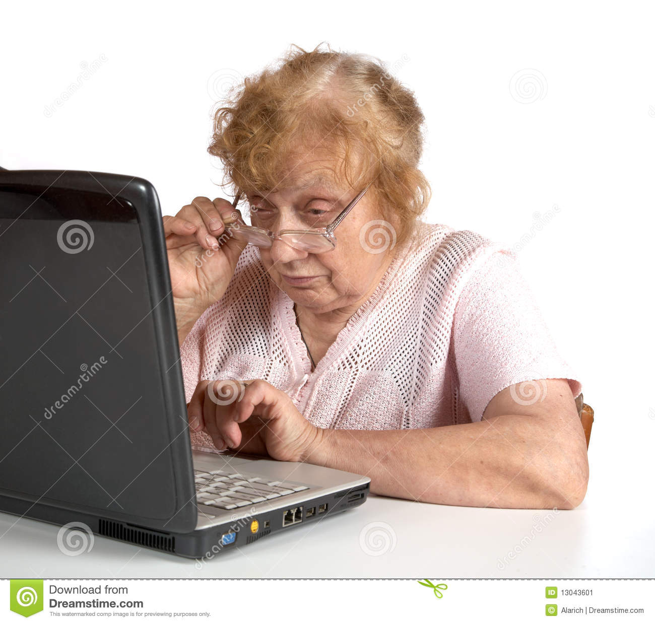 old-woman-glasses-looks-notebook-1304360