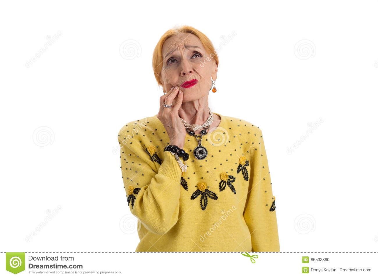 Old woman having toothache.