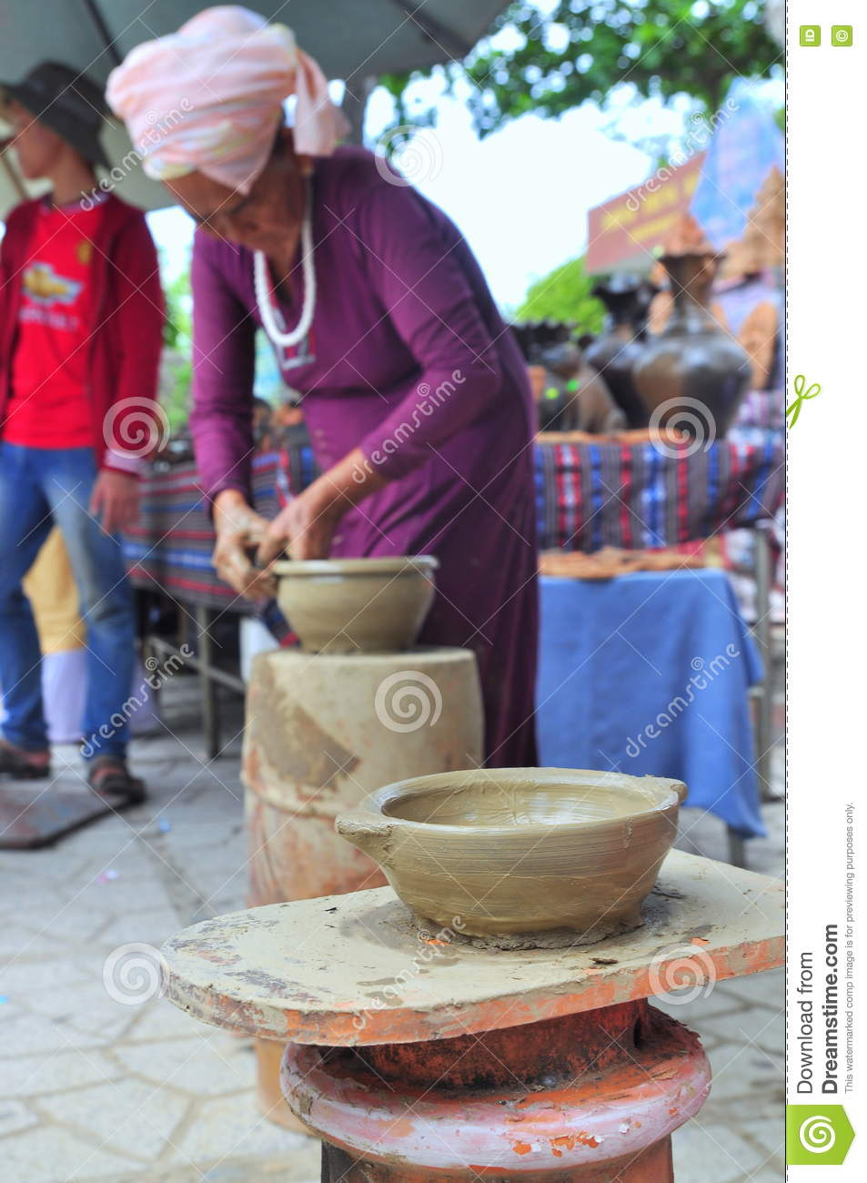 An Old Woman Is Performing The Ceramic Molding Techniques At