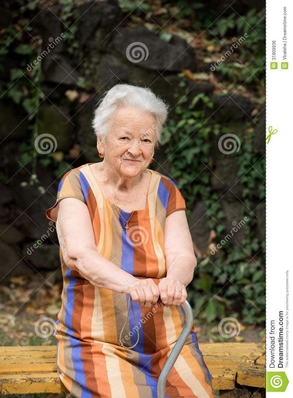 Old Woman Sitting On A Bench Royalty Free Stock Image