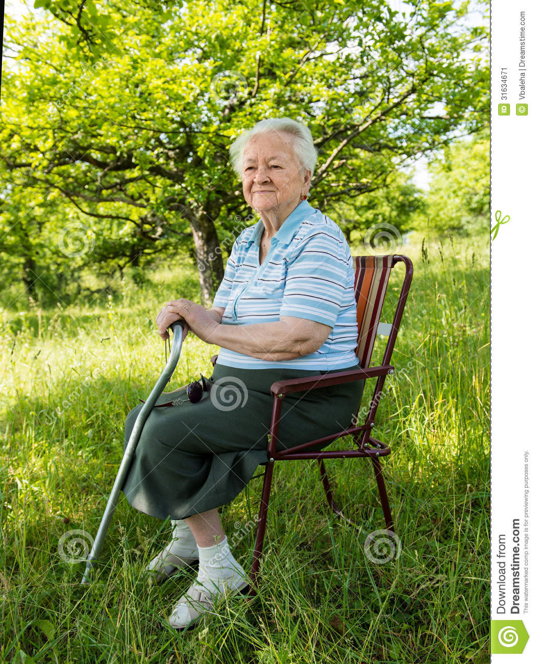 Old Woman Sitting On A Chair Stock Image - Image: 31634671
