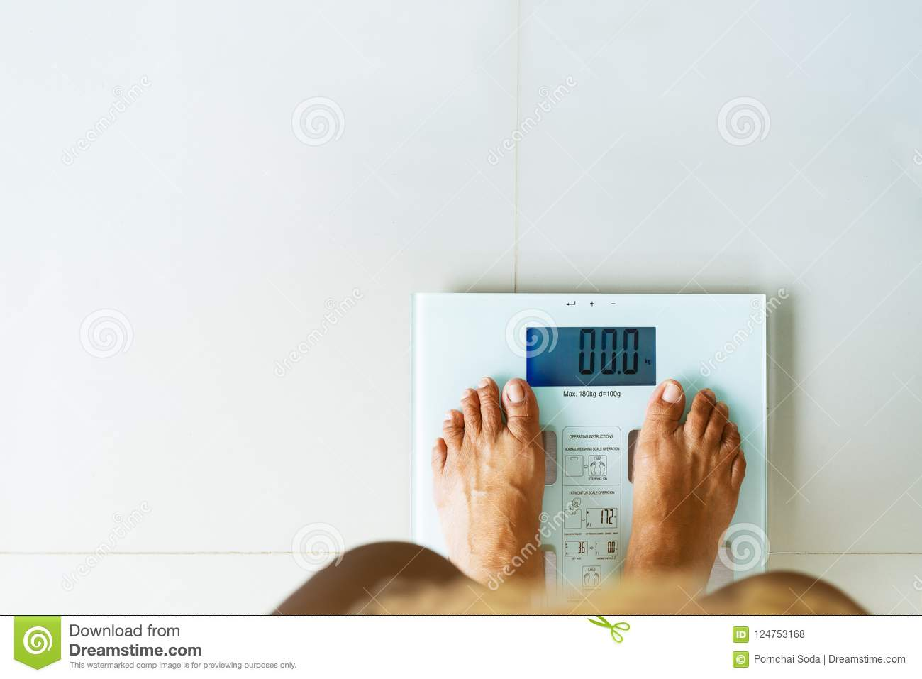 Old woman standing on weight scale white color