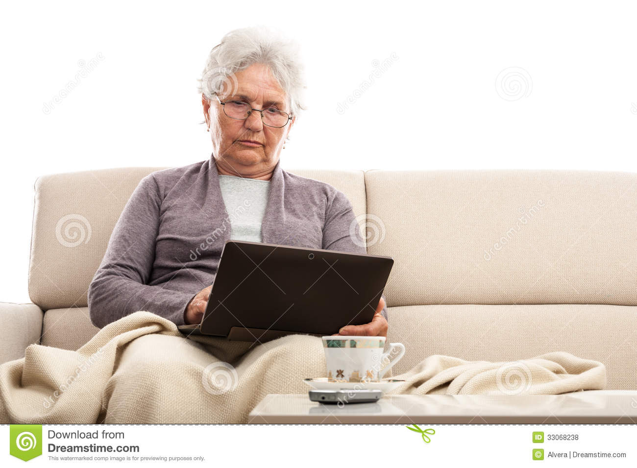 Old Woman Using Tablet With Keyboard Dock At Home Royalty