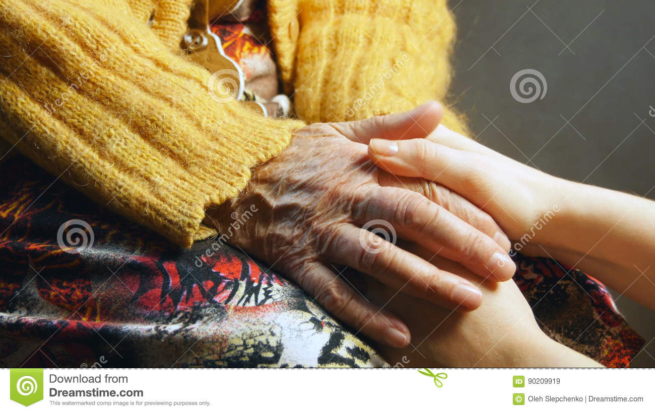 Old woman young girl hold hand wrinkle skin close up