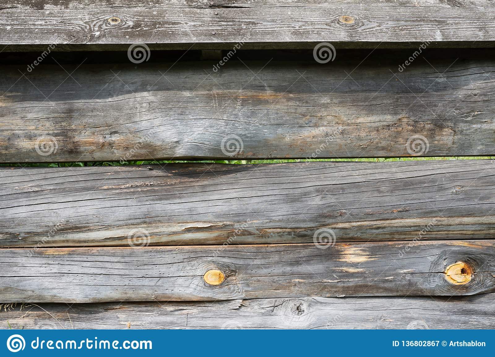 Old wood background. Close-up fence. The texture of the wooden fence