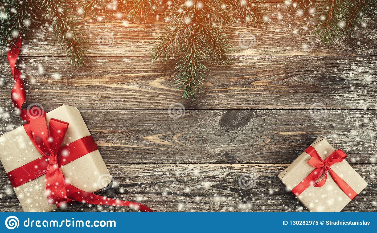 Old Wood Background With Fir Branches. Holiday Gifts. Christmas