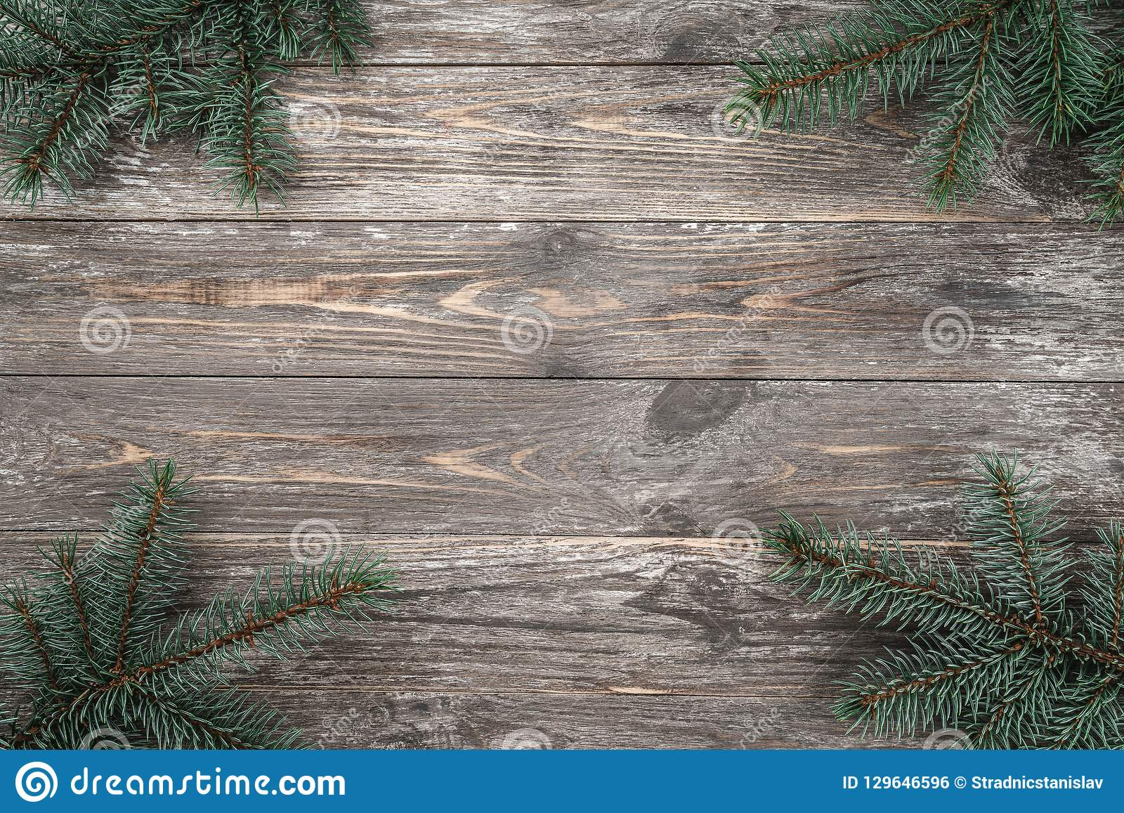 Old wood background with fir branches. Space for a greeting message. Christmas card. Top view