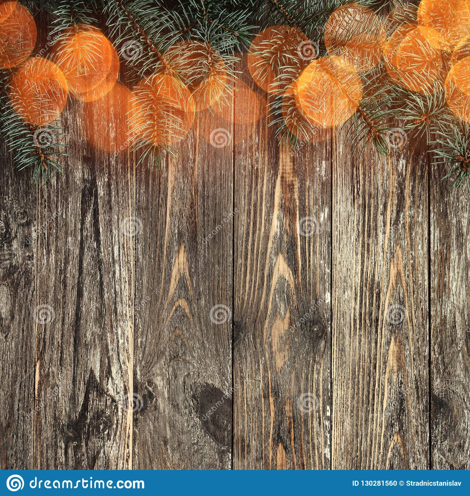 Old wood background with fir branches. Space for a greeting message. Christmas card. Top view. Congratulation card