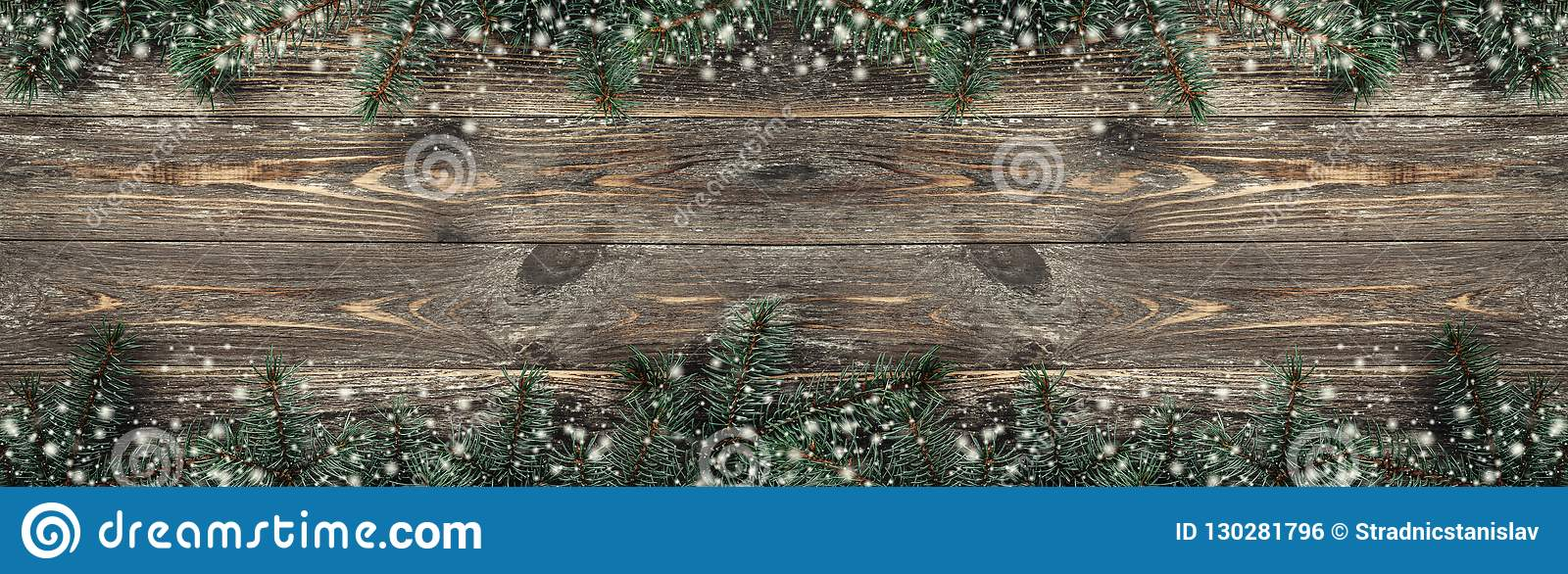 Old wood background with fir branches. Space for a greeting message. Christmas card. Top view. Effect snowflakes