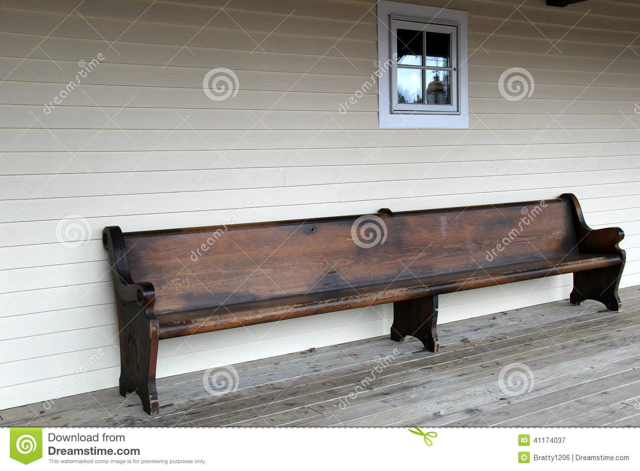Gorgeous Warm Wood Of Old Bench Invites People To Come And Sit For Awhile  On Country Porch.